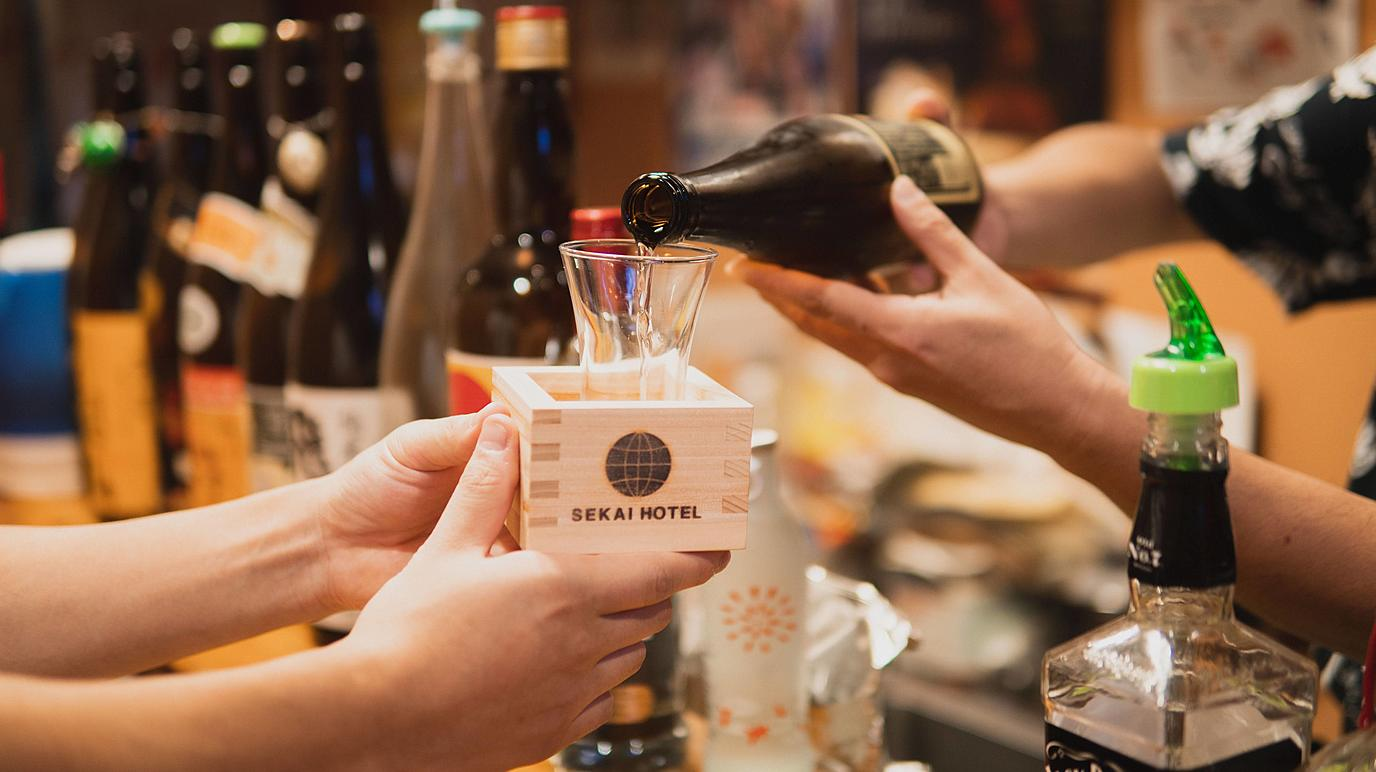 For couples: Visiting well-established local bars with an original masu container for drinking sake